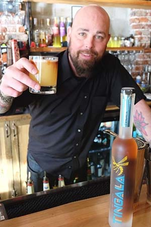 Bartender with Tingala Drink